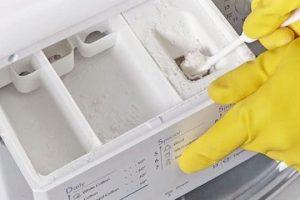 Чим відмити порошок в лотку пральної машини