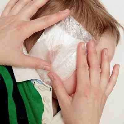 Горілчаний компрес на вухо